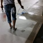 Applying Anti microbial oil eater to clean concrete